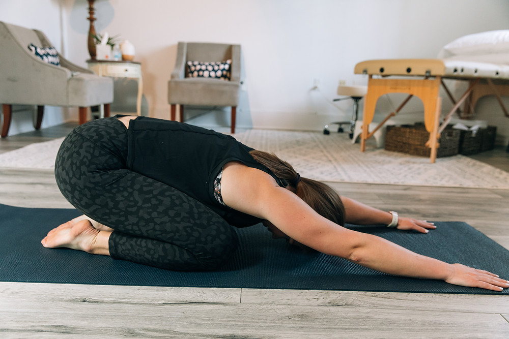 Child's pose stretch to relax pelvic floor