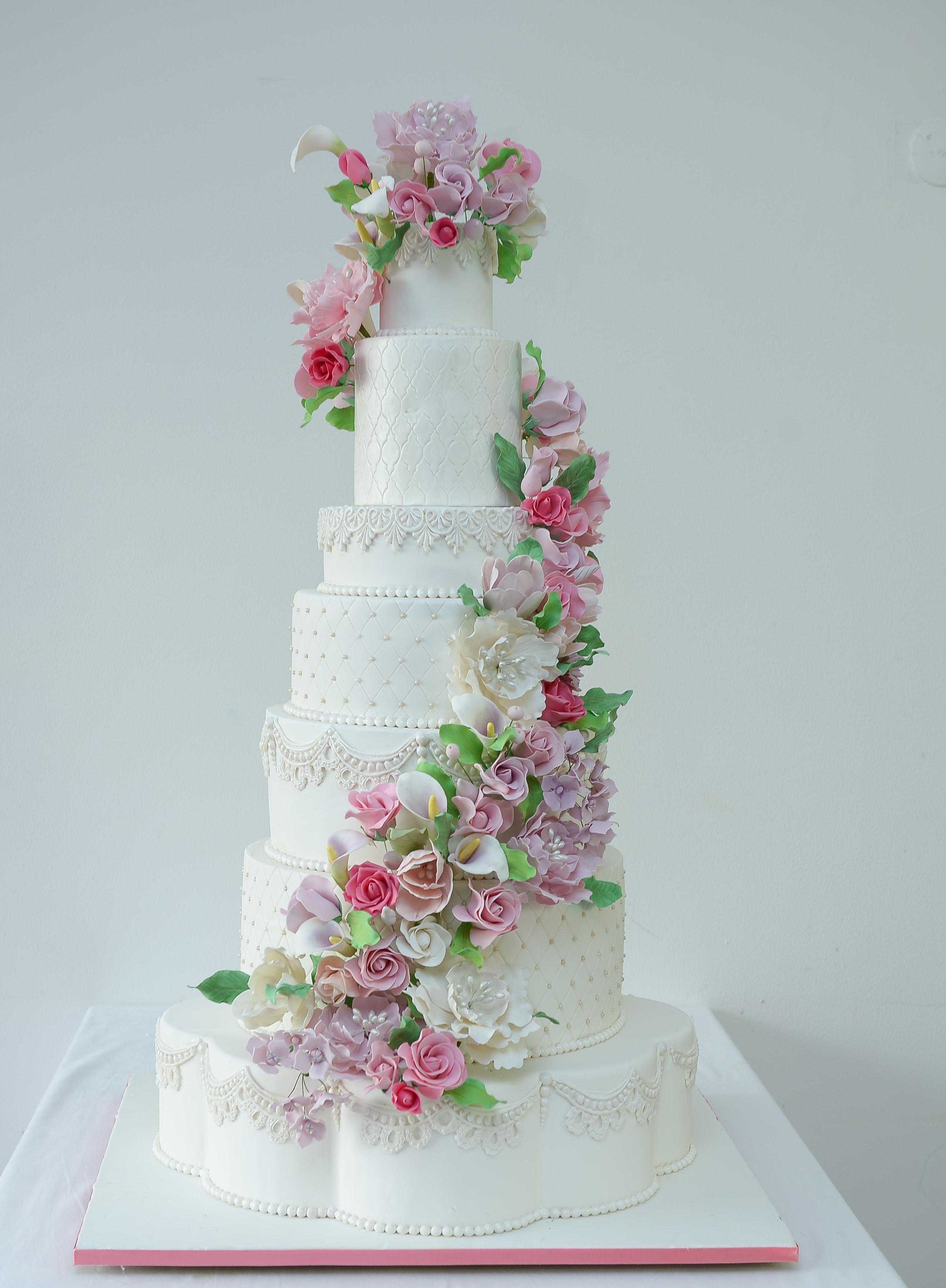 white wedding cake with sugar flower