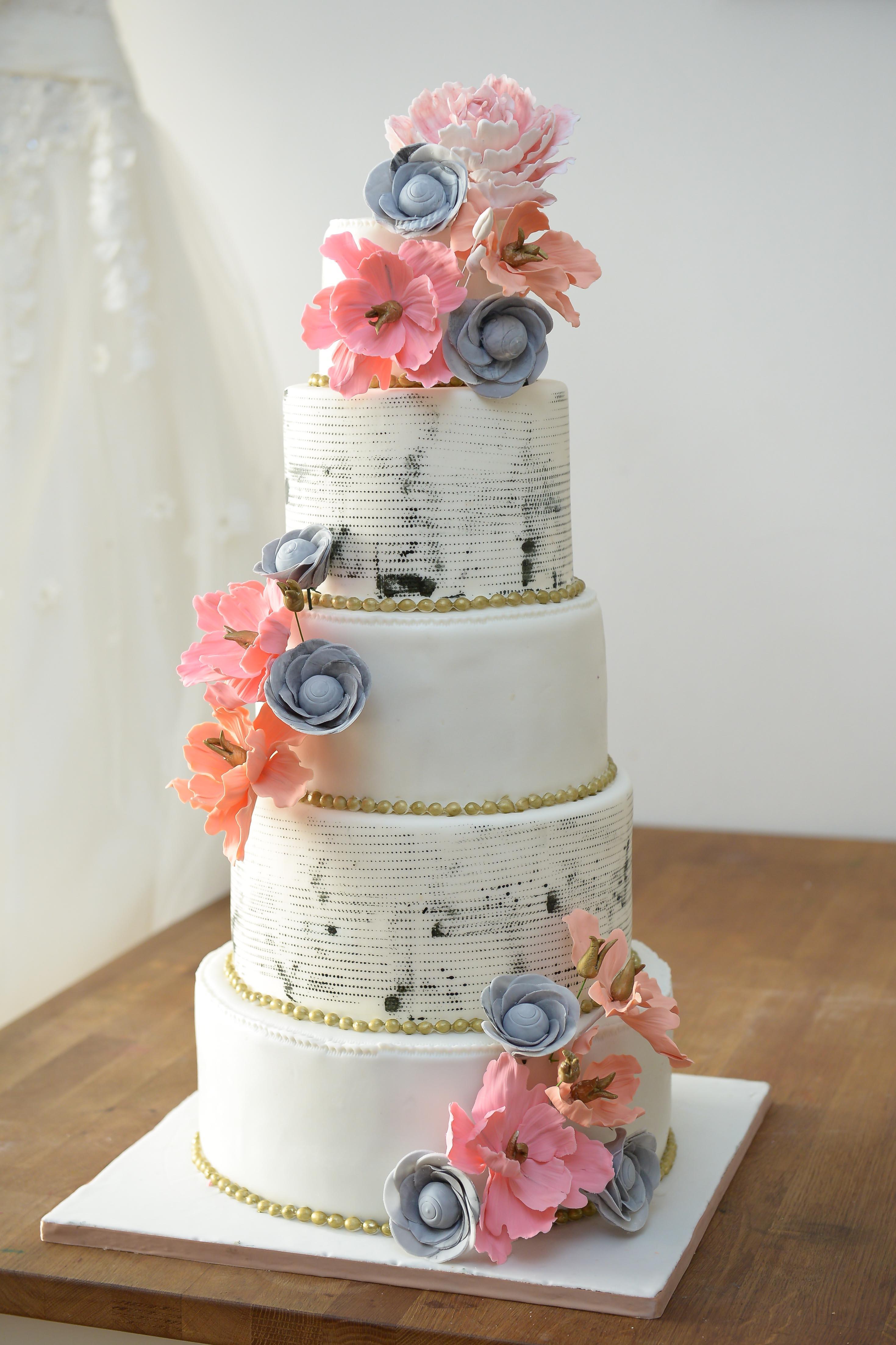 old newspaper print wedding cake