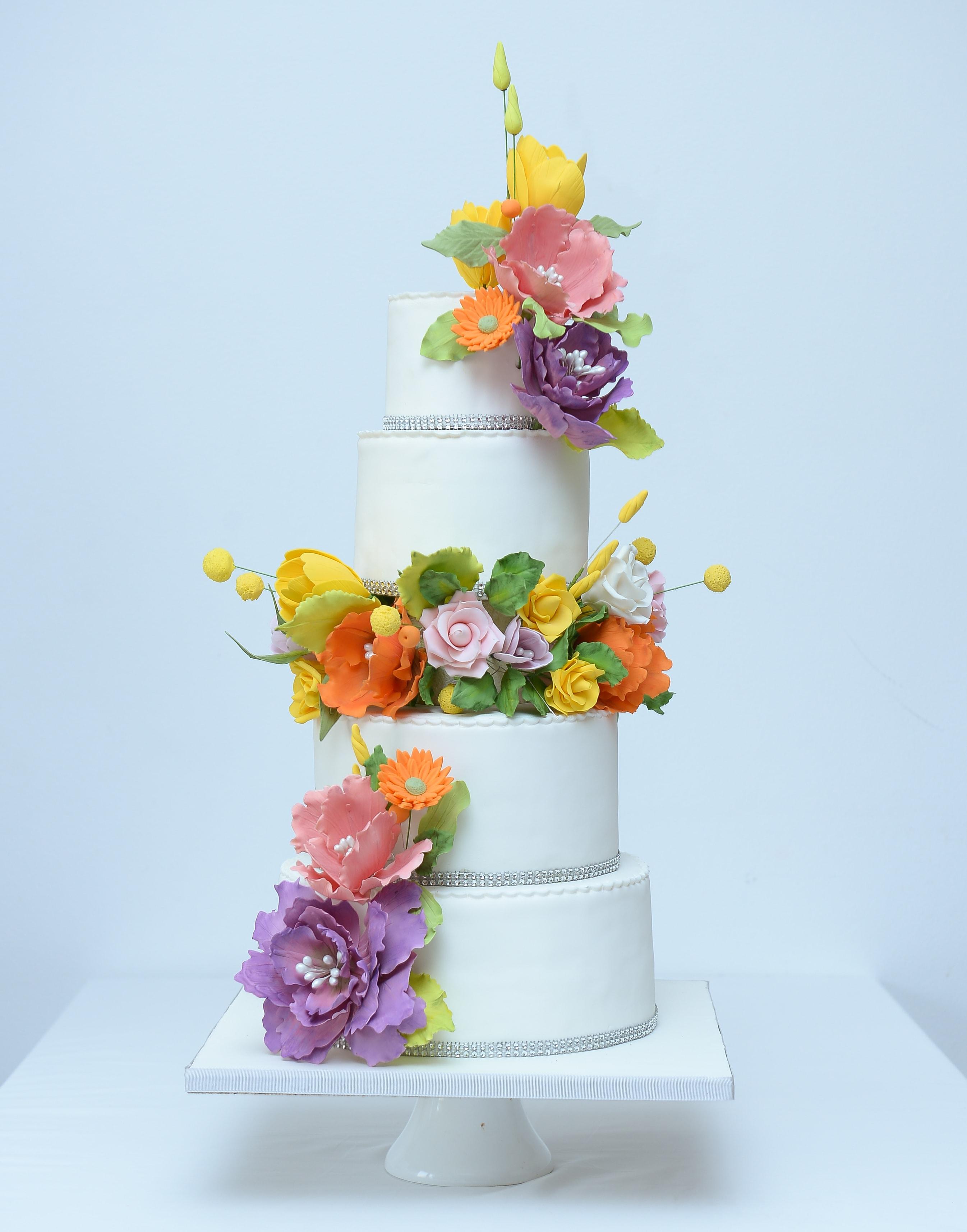 Tropical flower ring wedding cake