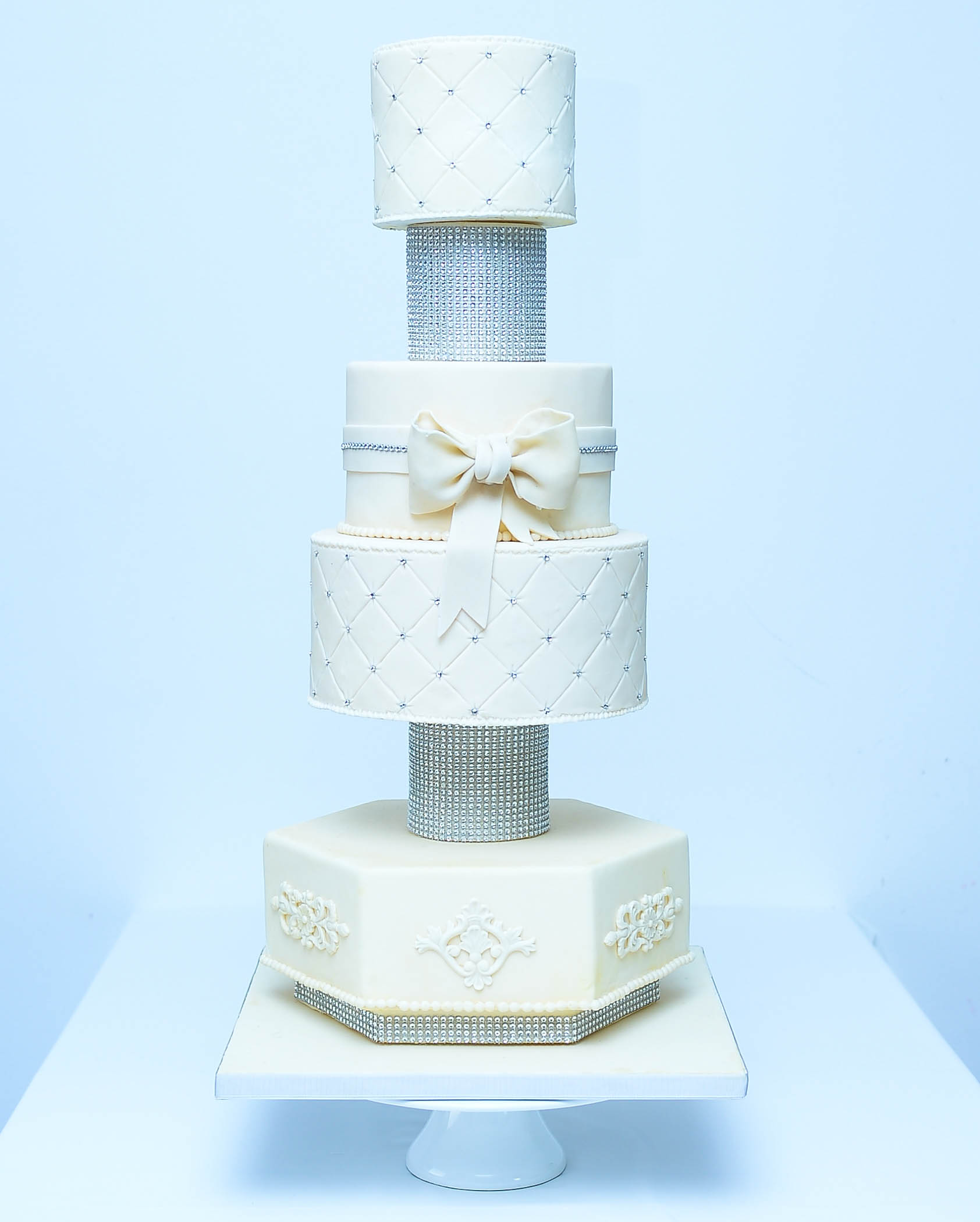 Tall white wedding cake with bling