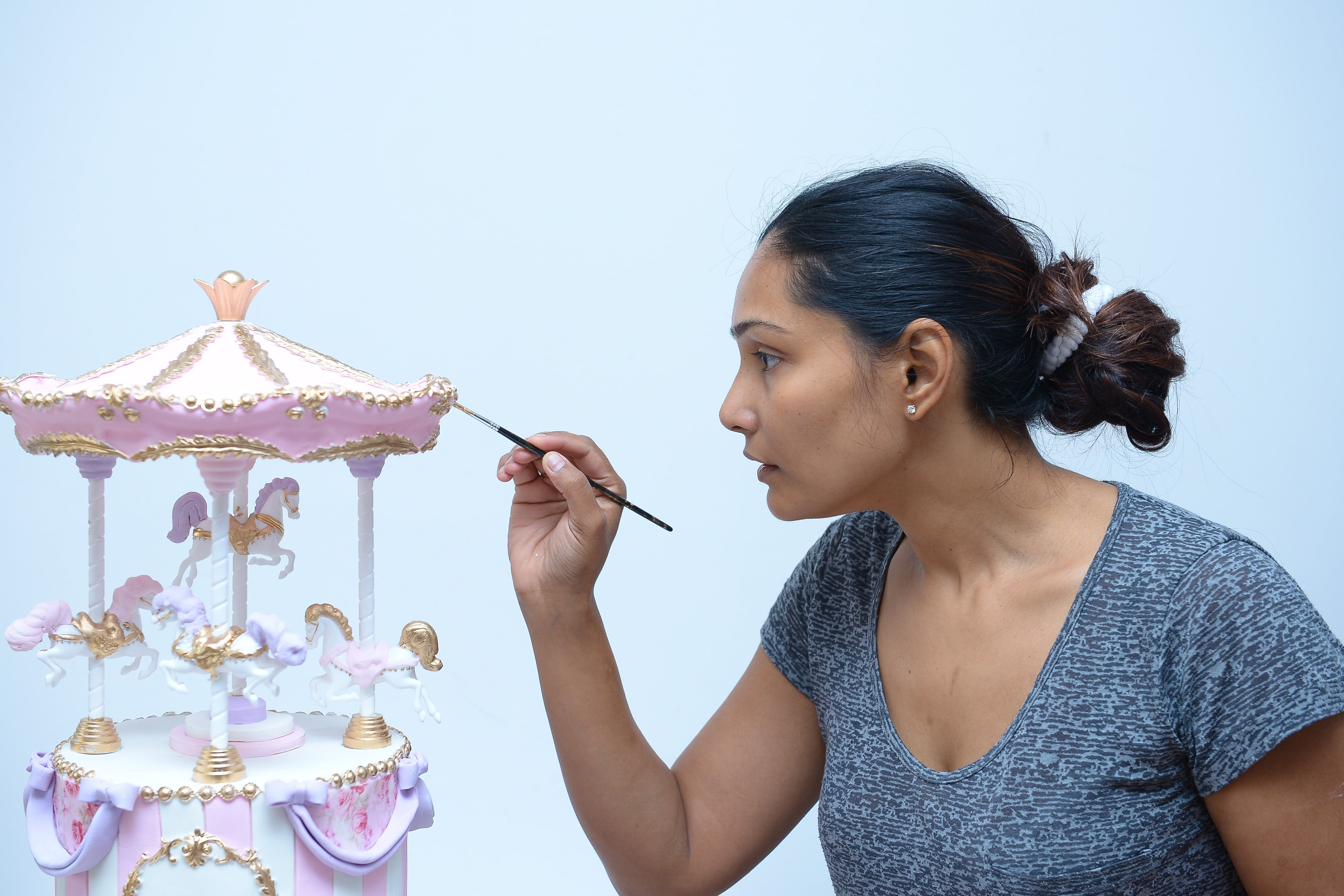 Chef Gayu painting the carousel cake