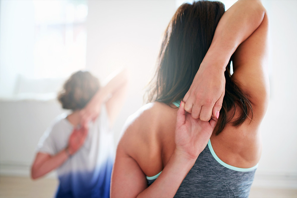 woman stretching back and shoulders | Align Chiropractic