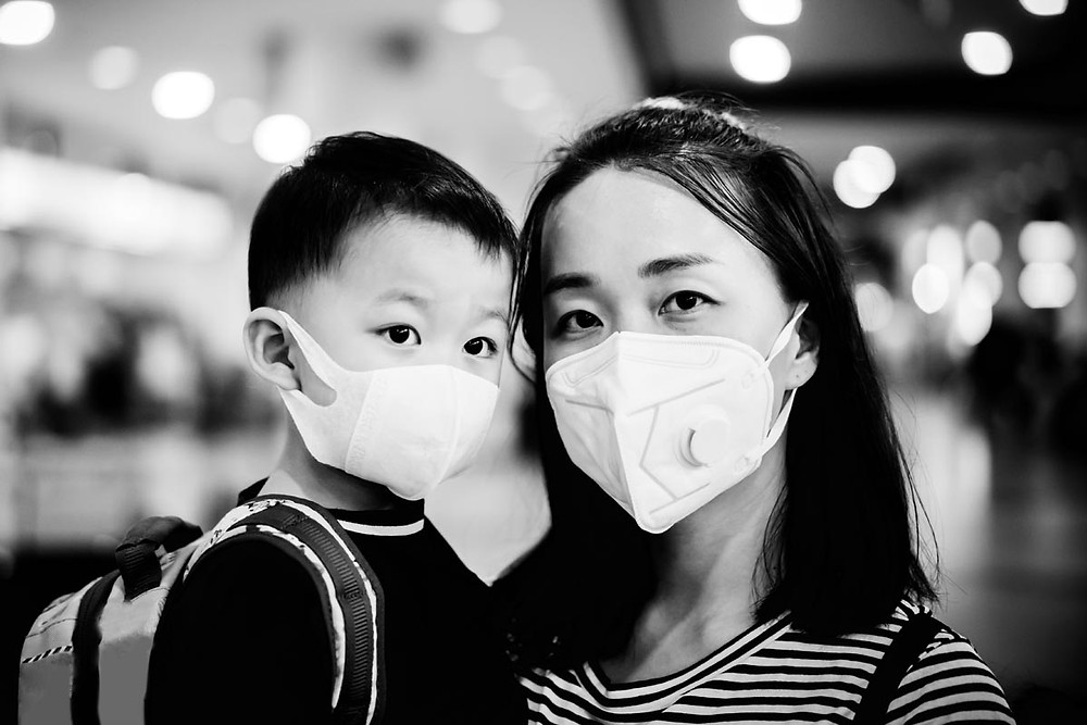 Singaporean Mom and son wearing surgical mask to prevent virus spreading