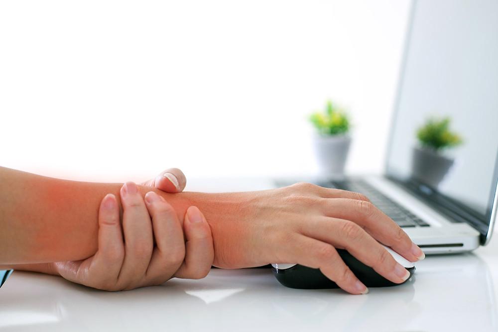 hand holding wrist pain and tightness