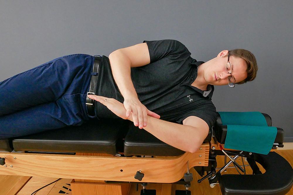 Side sleeper stretch for internal rotation of shoulder