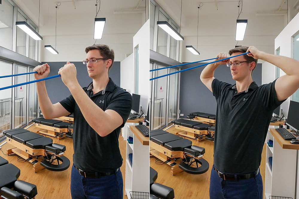 Banded face pull exercise for posterior deltoid imbalance.