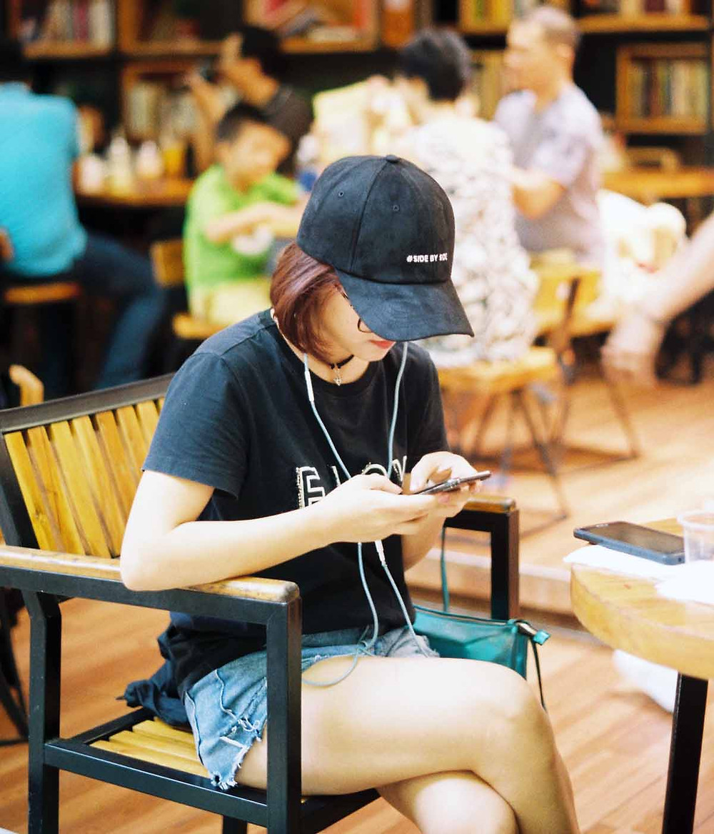 woman with bad posture using mobile phone