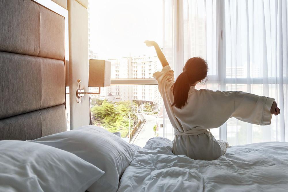 Woman waking up feeling refreshed