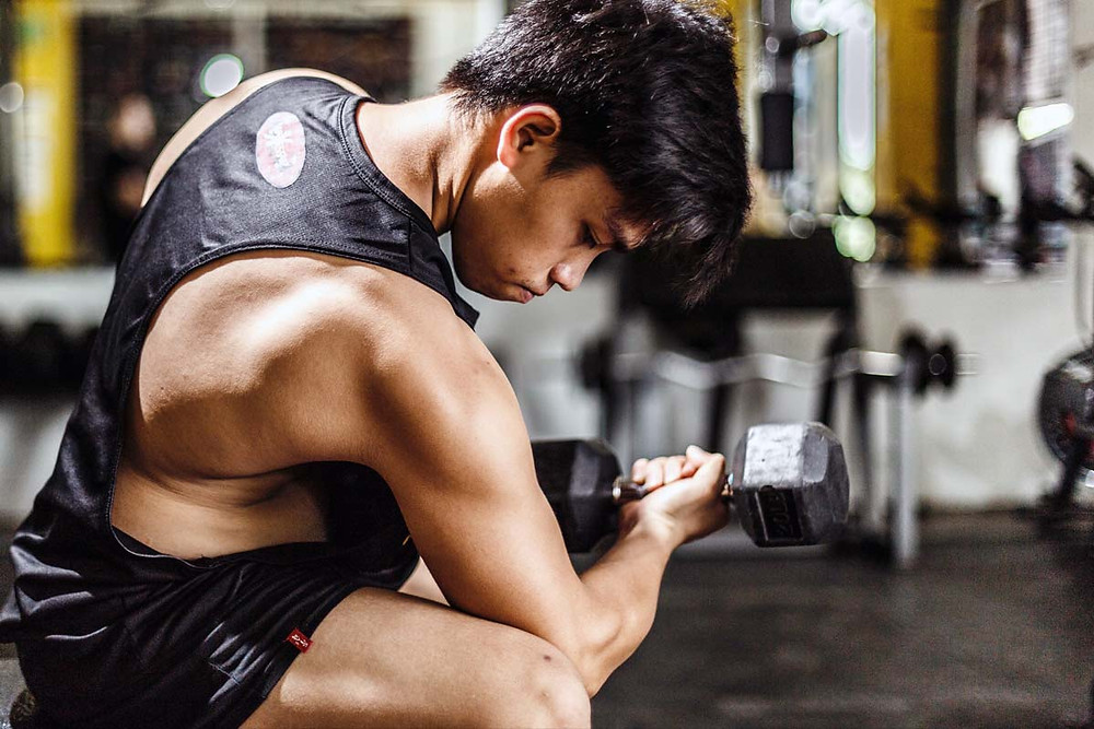 Young asian man in his 30s working out