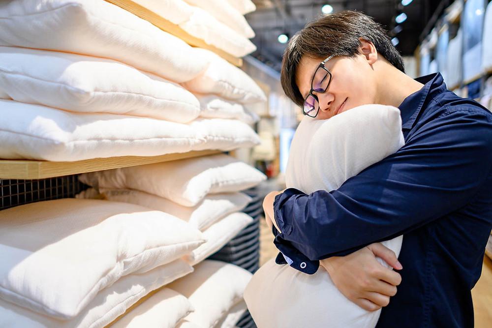 Man hugging a pillow