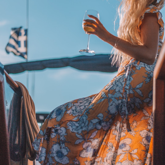 A glass of wine on board