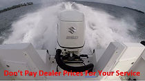 Suzuki 250 on boat dealer service.JPG