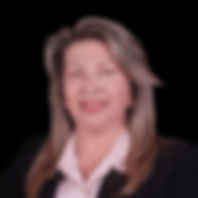 Dra Aris our co-founder is a woman with long paintedblond hair, red lipstick, a pink sir and a black suit jacket.