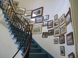Spiral Staircase with Gallery Wall