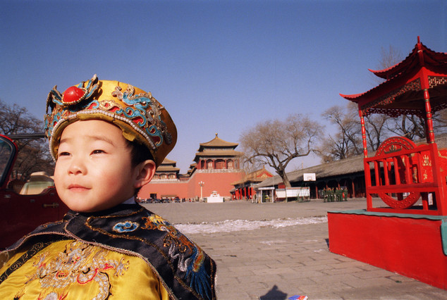 Child crying as he is made to pose as Qing Emperor