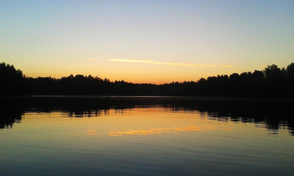 Sunset in lake in Savitaipale