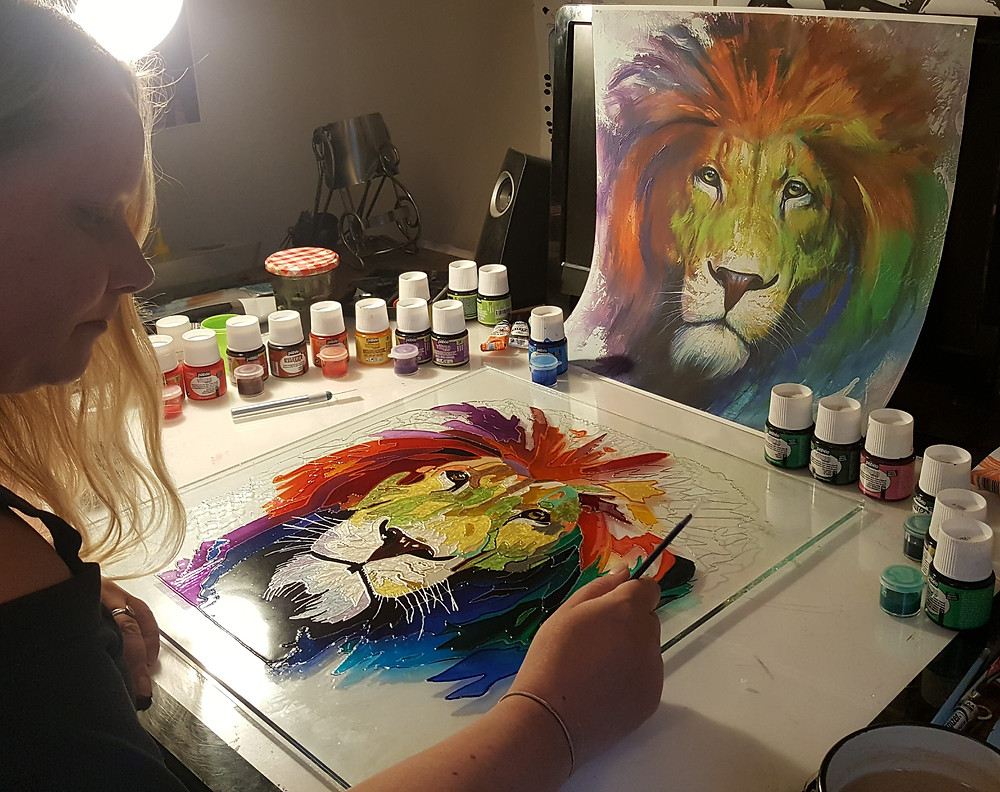 Me painting a Buster Fisher lionon to glass