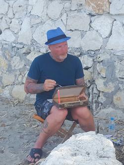 Rob paintig on a beach.jpg