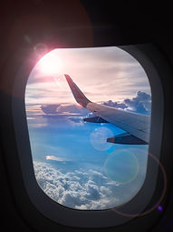 The wing of airplane and sunset on sky b