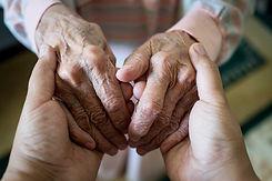 Young woman holding elder hands.jpg