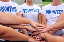 volunteer group with hands together