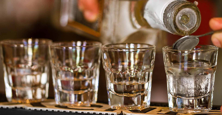 non-alcoholic spirits being poured into