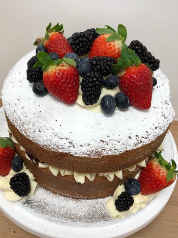 Summer victoria sponge topped with fresh fruits 8inch.