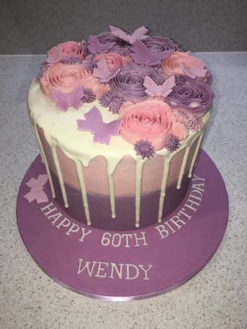 7inch Floral 60th birthday drippy cake.