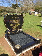 Kerb memorial with heart stone