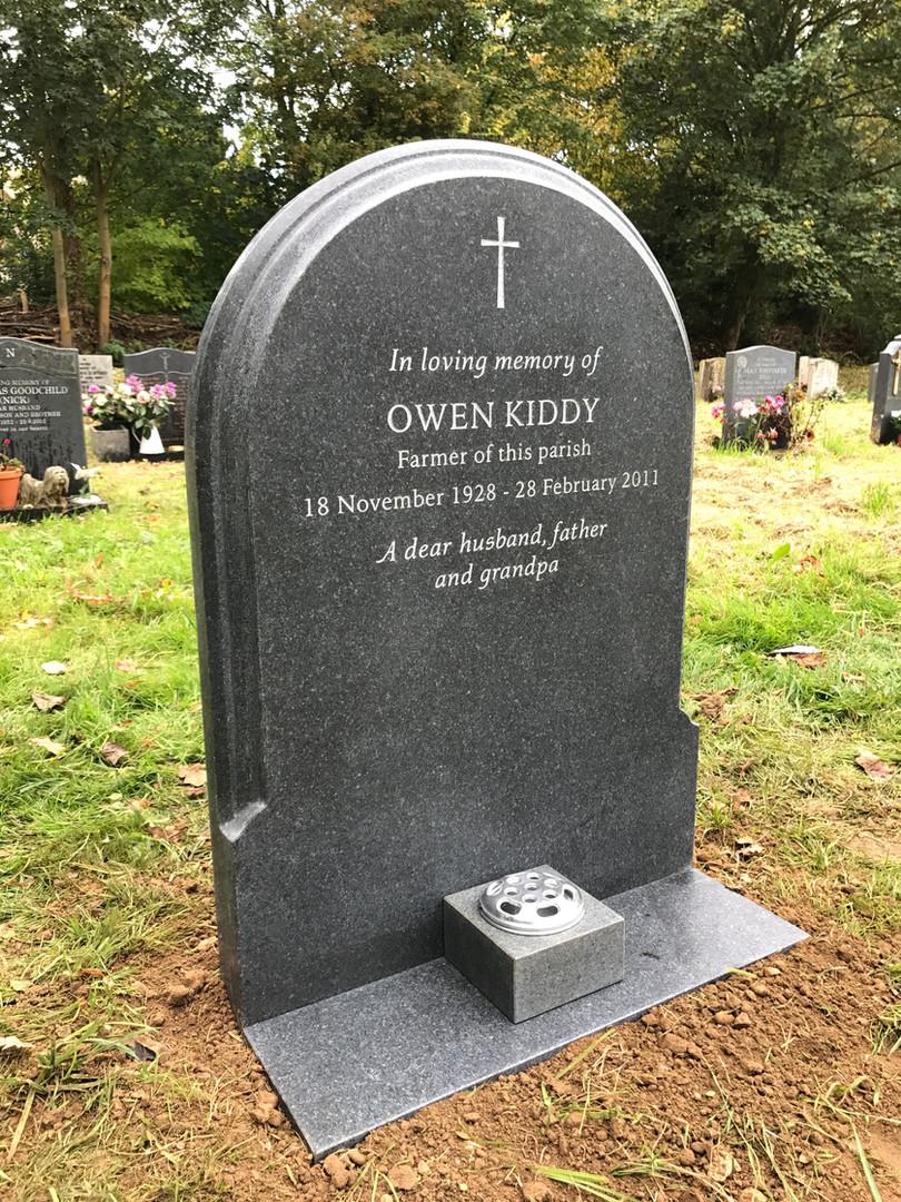 Granite headstone and vase