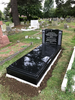 Headstone with kerbs and cover slab