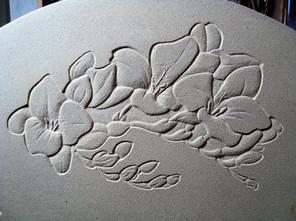Stone carved flower design