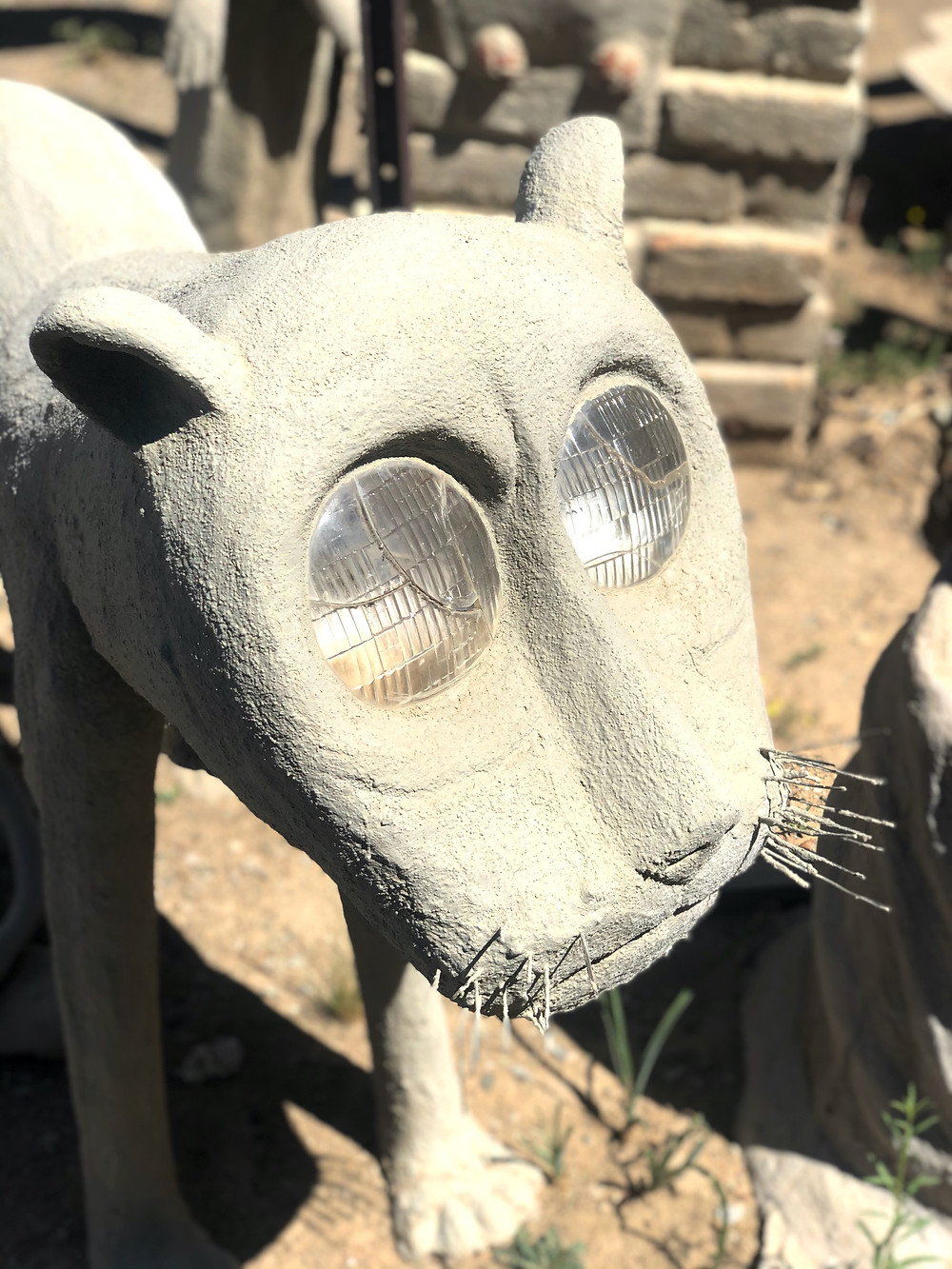 Lion sculpture wire whiskers headlamp eyes cement art