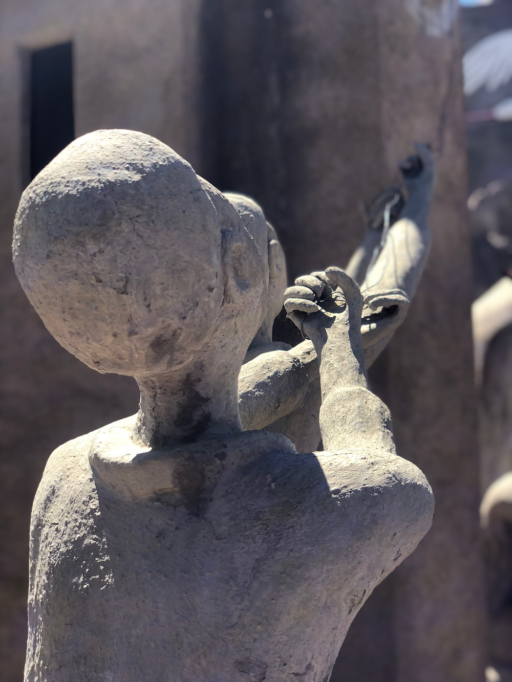 Cement sculpture, hands of time, growing old, live forever