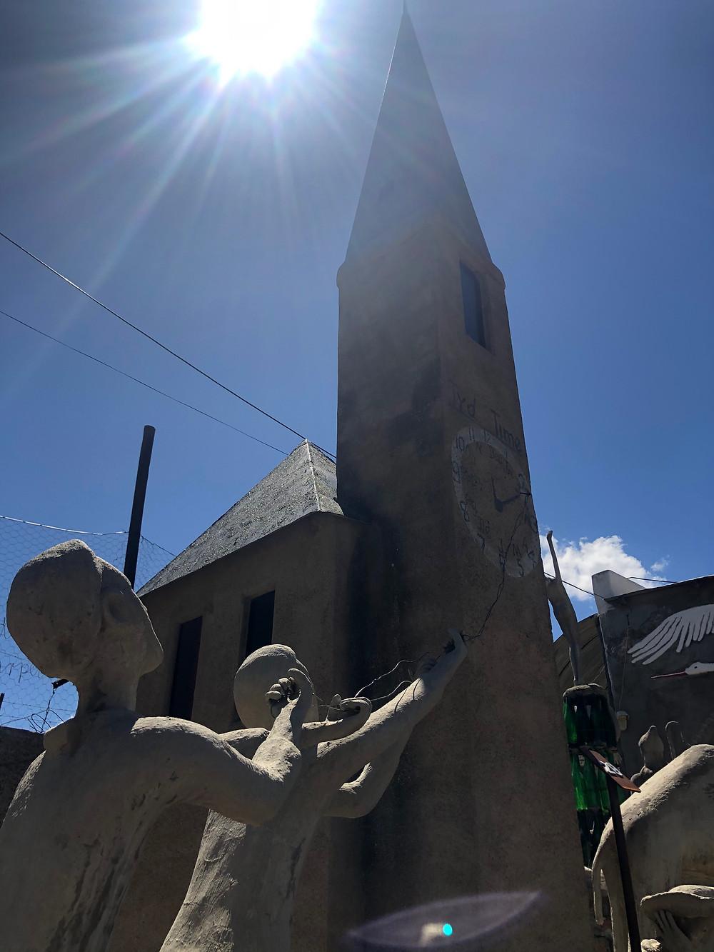 Church spire, turn back time, relativity