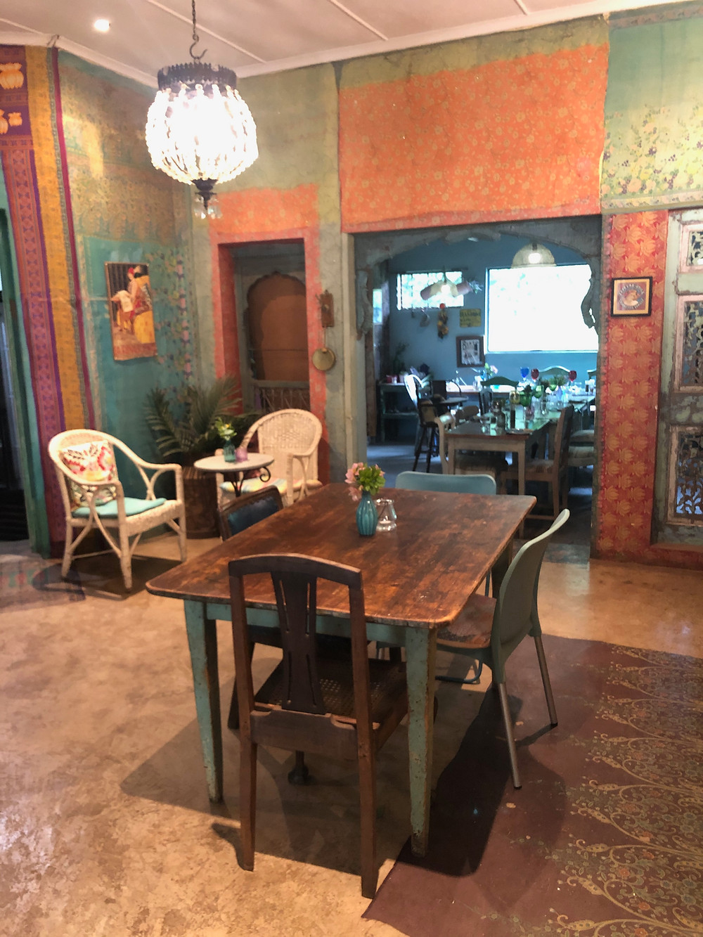 Eclectic Interior, Polished cement floor, steel float cement floor, moroccan interior, french interior, wooden table, wooden dining table, wallpaper, wall design, wall facing, Persian carpet, wicker chairs,