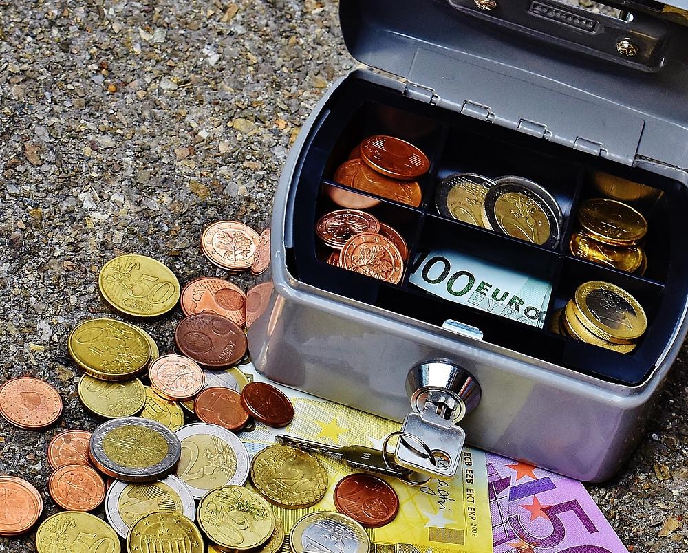 Box full of coins euros