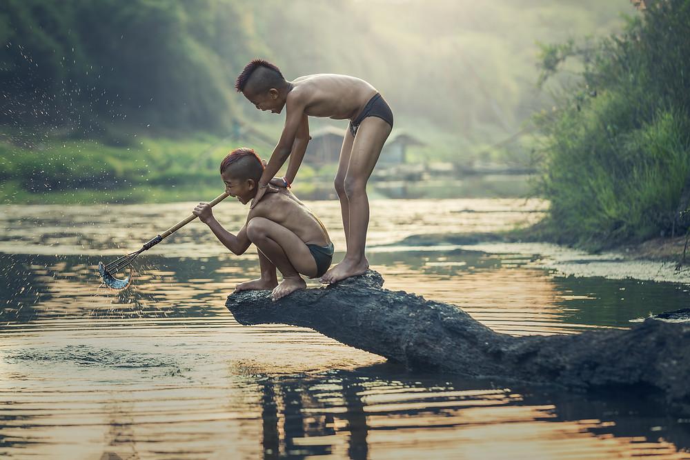 Children having fun fishing