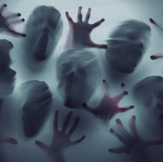 screaming-ghost-faces-picture-id1051146310.jpg