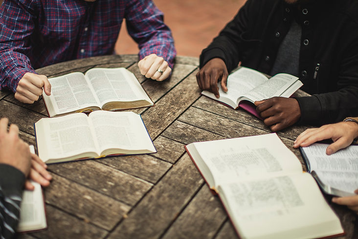 Young men Disciples of Jesus reading the Bible together