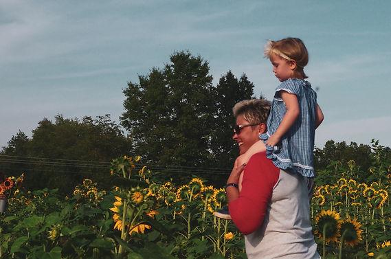 resized_little girl on shoulders in sunf