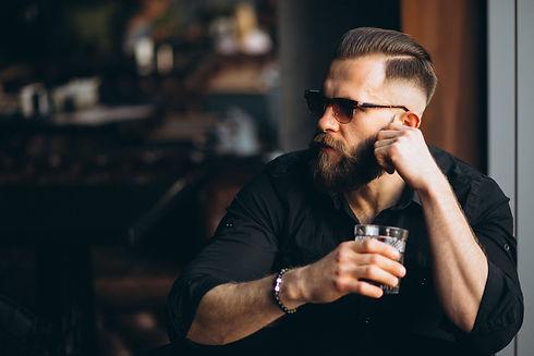 bearded-man-drinking-in-bar-c.jpg