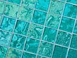 High quality American made Lightstreams Glass Tile Gold Iridescent Collection Aquamarine glass tiles are a beautiful blue / green / aqua color on the shiny side of the tile, with metallic iridescent colors on the reverse side. This green tile / blue tile can be used for pool tile, spa tile, wall tile, floor tile, backsplash tile, kitchen tile, shower tile, bathroom tile, waterline tile, step marker tile, fountain tile, spillway tile, and even accent tile,