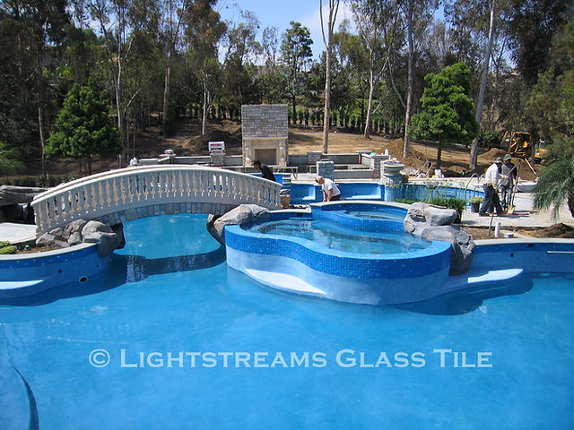 American Made Lightstreams Glass Tile Turquoise is used as pool tile, spa tile, waterline tile, bathroom tile, shower tile, and step marker blue tile