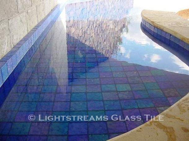 American Made Lightstreams Glass Tile Renaissance Collection Sky Blue tile is used as pool tile and spa tile in this indoor / outdoor all tile pool and spa with only the iridescent tile side showing