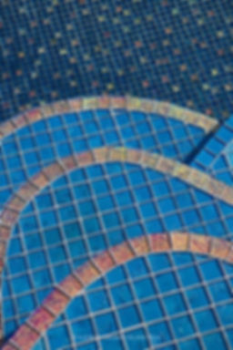 American Made Lightstreams Glass Tile Jewel Accent Tile Red River in this all tile pool with Jewel Red Tile bullnose pieces used as step marker tile. Also can be used as pool tile, waterline tile, spa tile, backsplash tile, kitchen tile, floor tile, wall tile, mosaic tile, bathroom tile, fountain tile and shower tile.