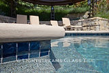 American made Lightstreams Glass Tile pool tile in Gold Iridescent Collection Steel Blue pool tile on the pool waterline