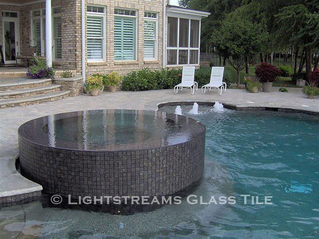 American Made Lightstreams Glass Tile Gold Iridescent Collection Silverado grey tile / silver tile is used for this all tile spa tile. Can also be used for pool tile, fountain tile, fire pit tile, wall tile, waterline tile, step marker tile, exterior tile, interior tile, accent tile, iridescent tile, backsplash tile, kitchen tile, bathroom tile, floor tile, and shower tile