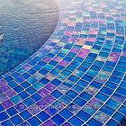 American made Lightstreams Glass Tile is used for pool tile, spa tile, waterline tile, step marker tile, accent tile, wall tile, fountain tile, floor tile, bathroom tile, shower tile, kitchen tile, and kitchen backsplash tile. This all tile fountain is using Lightstreams Renaissance Collection Sky Blue in 2x2 tile size.
